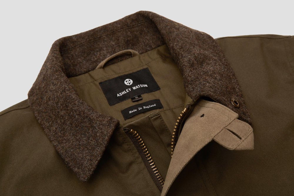A melton wool collar provides warmth and comfort on colder days.