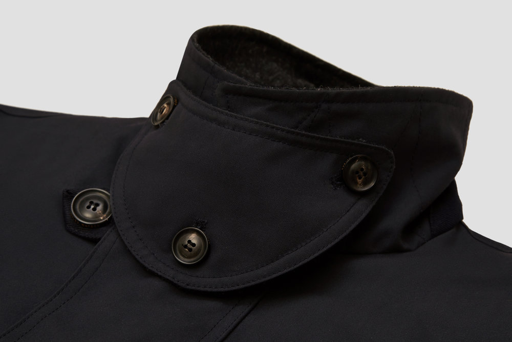 Our signature three-button storm baffle protects the neck from the elements.