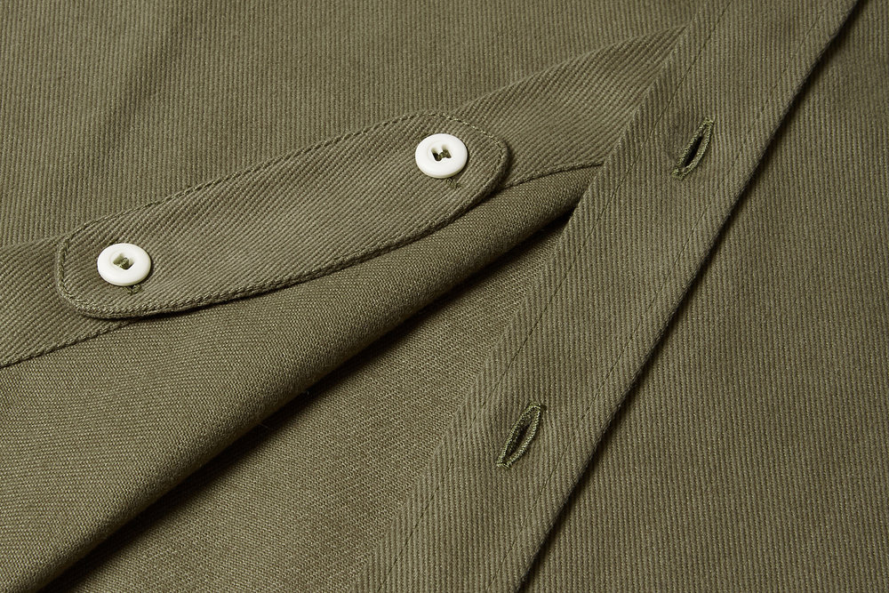 When not needed, the collar tab can be stowed on the inside of the placket as shown.