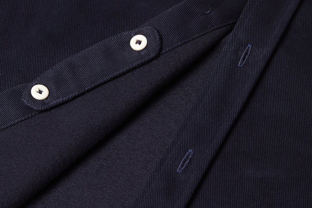 Wool Collar for ComfortWhen not needed, the collar tab can be stowed on the inside of the placket.