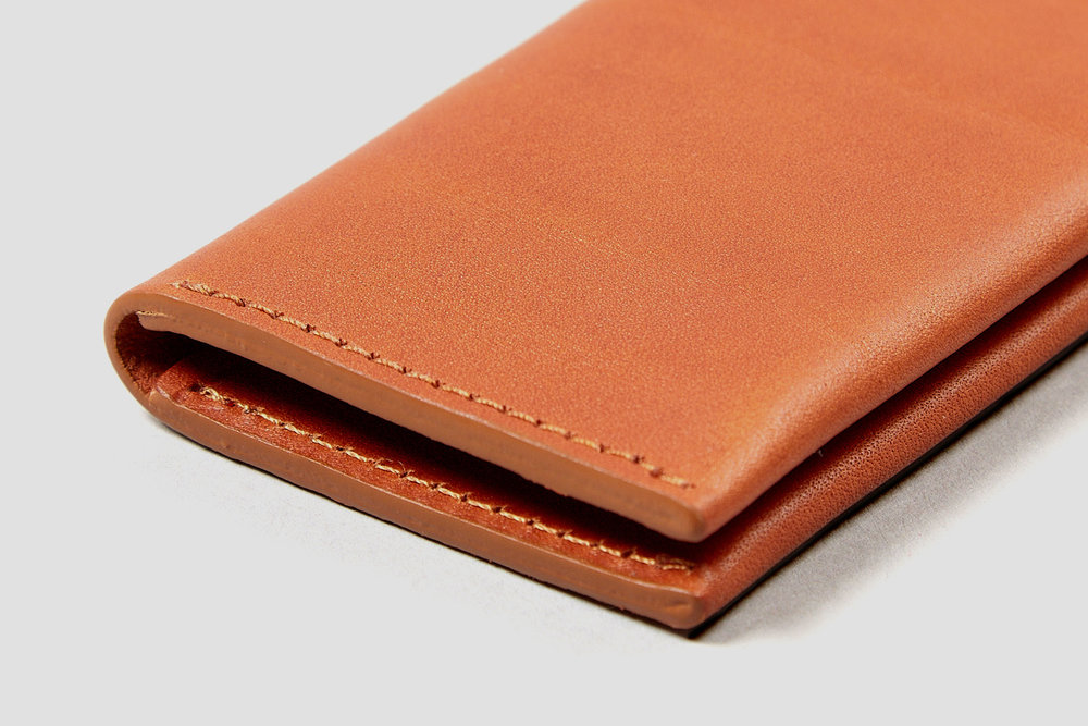 The edges of the card holder are hand painted to seal the leather and improve durability.