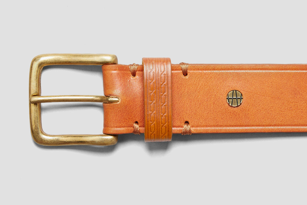 The Ilkson Belt is finished with a patterned belt loop and our signature monogram rivet.