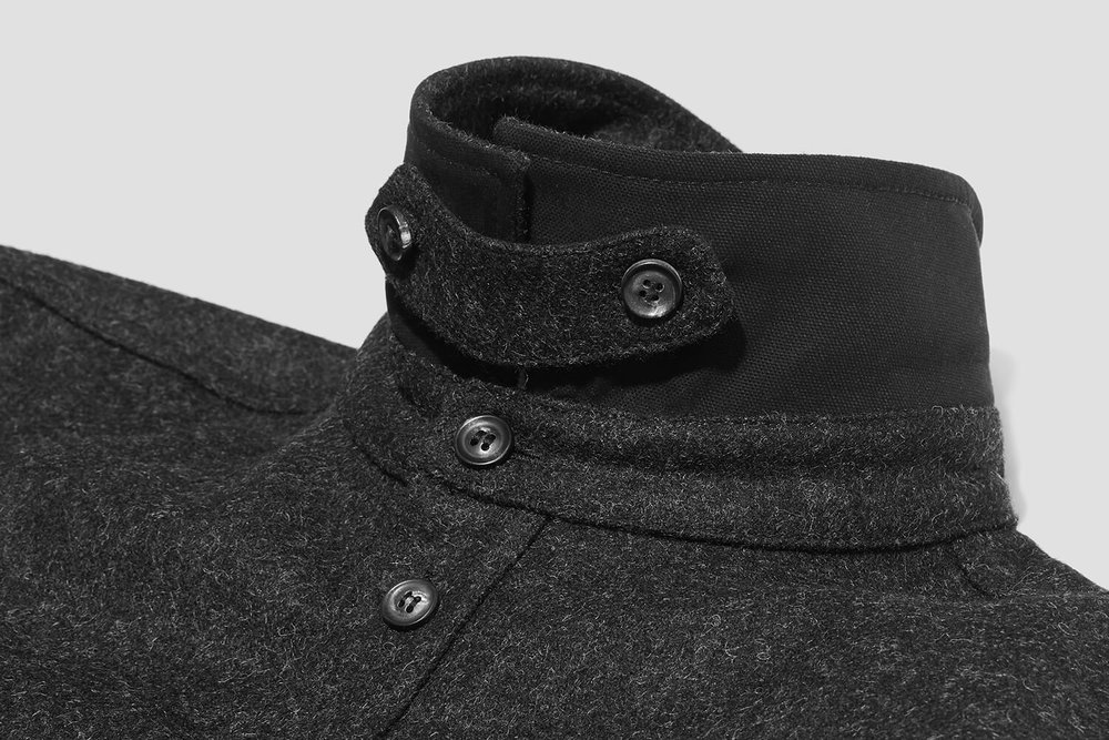 A removable collar-tab that closes the neck, reducing wind chill when on two wheels.