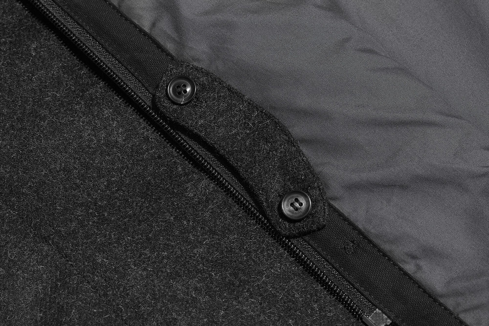 When not needed, the collar tab can be stowed on the inside of the placket.
