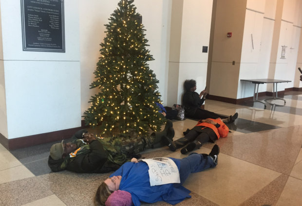 Frank Matthews and several others lay on the floor of Homewood City Hall Monday, Dec. 5, 2016, in protest of a woman's detention during a felony theft investigation at Walmart on Dec. 1.
