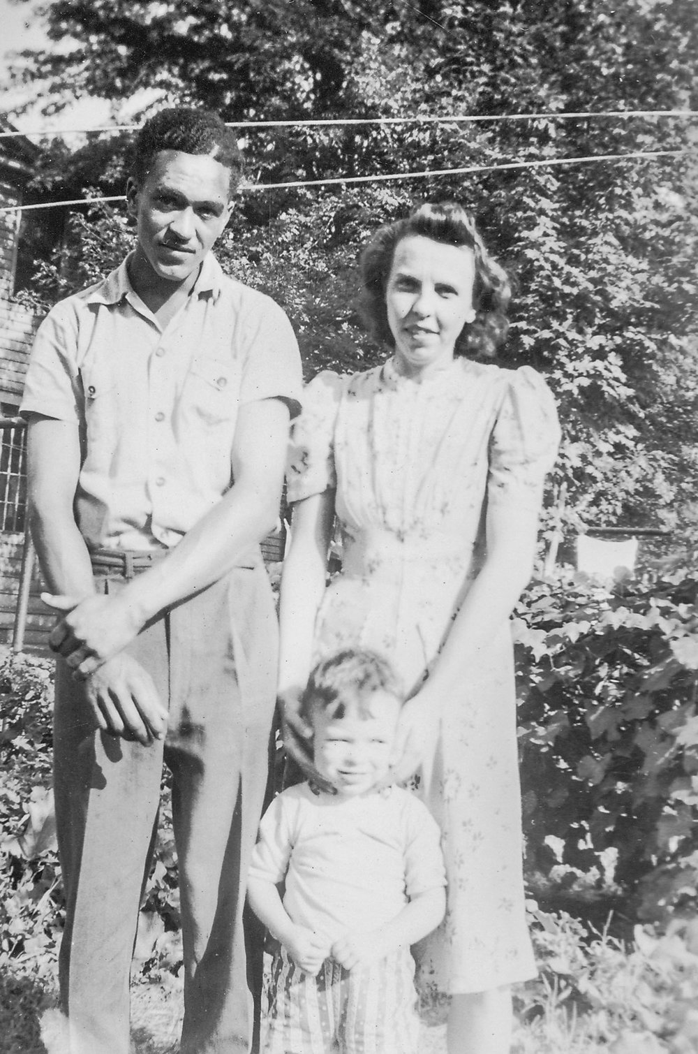Photograph of Fran Linzy, his wife Anne Linzy, and their child Junior Linzy, taken in Geneva NY in the 1950's