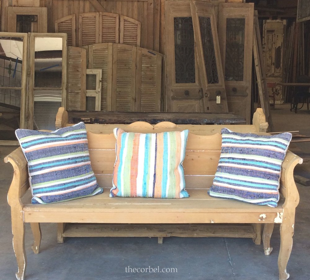 antique bench with summer pillows.jpg