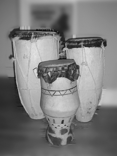 Petwo drums (Tanbou Petwo), Carved wood covered with goat-skin attached with ropes; (left) Manman or Baka; (right) Rale or Ti-Baka; (foreground) Kata