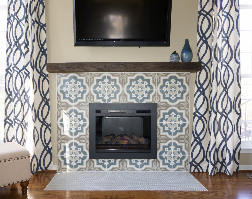 Their builder grade fireplace was updated in the mosts fab way with this new tile surround and reclaimed wood beam mantle.