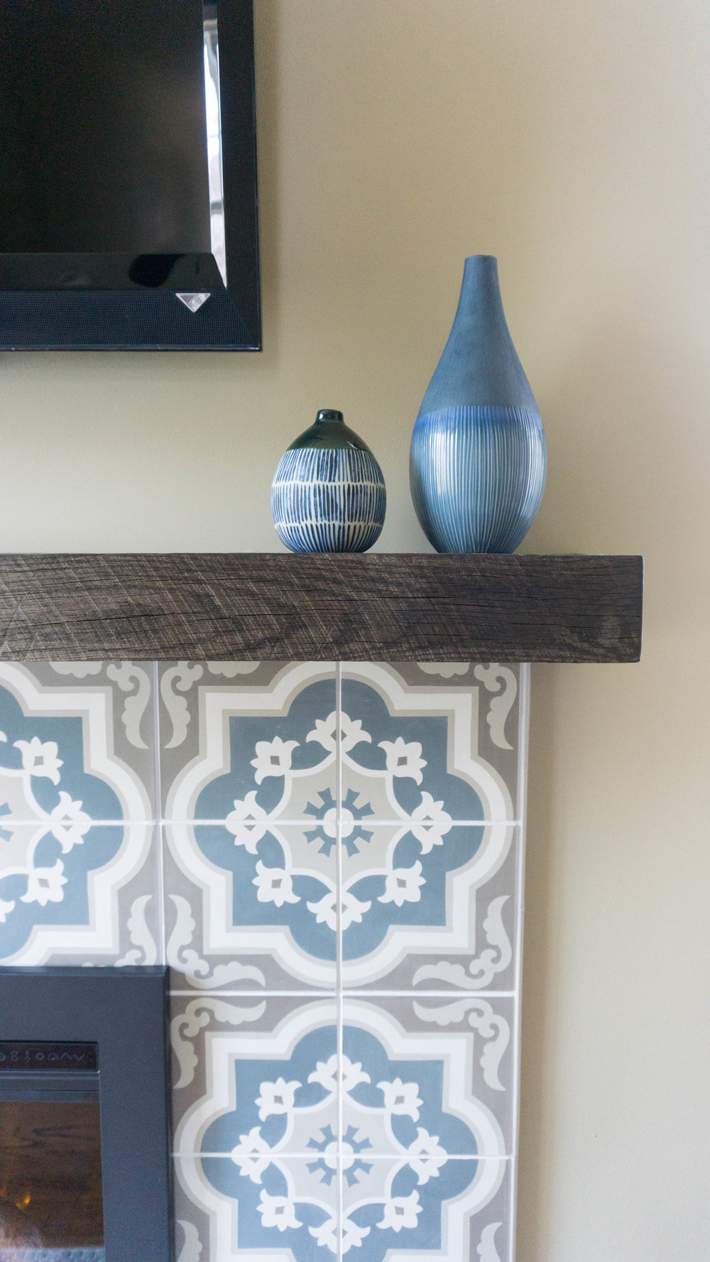 I could not be more obsessed with this tile, mantle and ceramic jar combo.