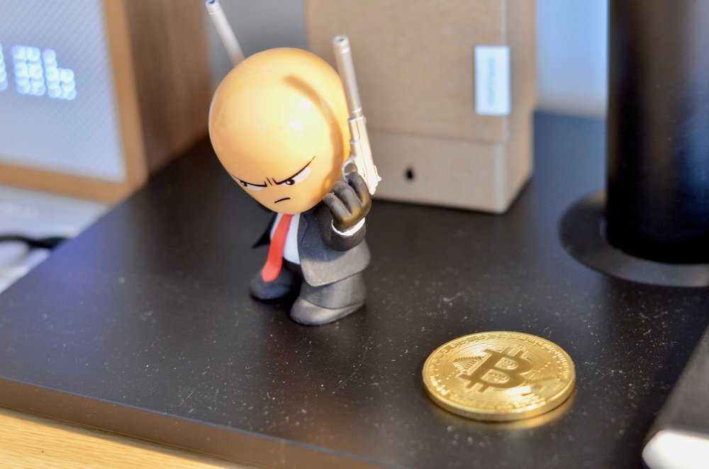 And finally, my Hitman figure and a bitcoin that isn't actually worth anything.