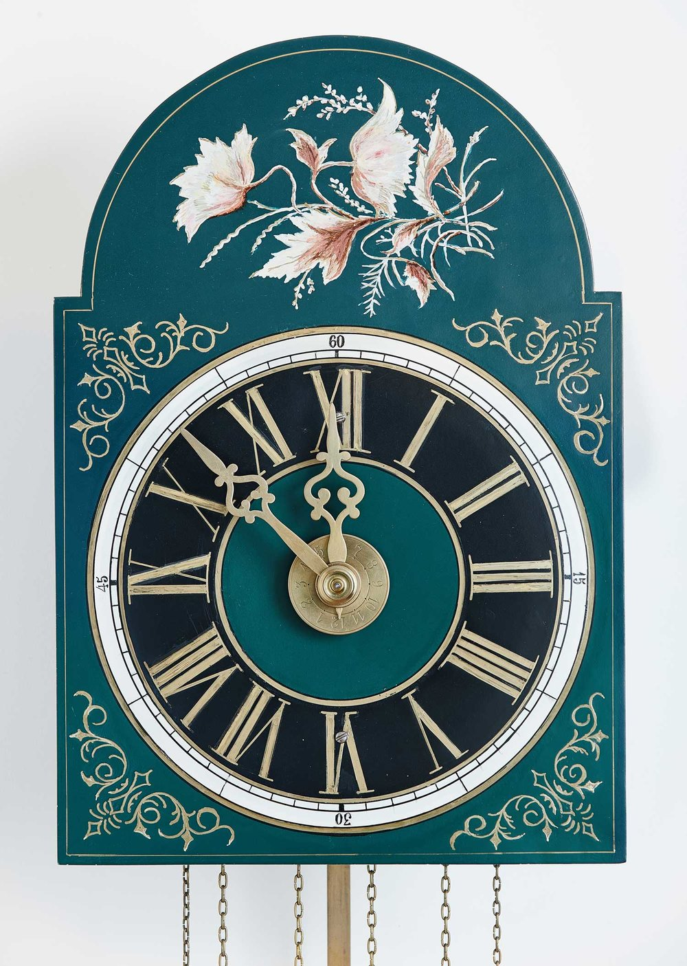 Kroeger Clock  made ca. 1910, restored and repainted by Arthur Kroeger. Early clocks had flat dials but around the mid-19th century clockmakers began hammering out the area around the numbers resulting in a raised dial. Background photo: A Mandtler clock made in 1899.