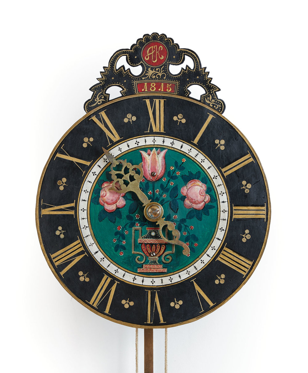 This clock has roses for Rosenthal, the village where the clock was made and whose name translates to 'Valley of Roses'; tulips for the Netherlands, from where the Mennonites descended; and a Greek vase for Taurida, once an ancient Greek province, now part of southern Ukraine, where Rosenthal was later located.
