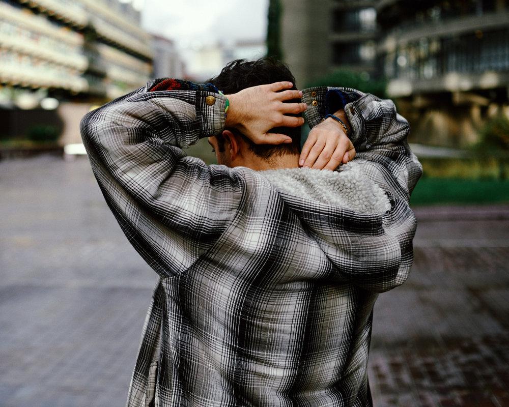 portrait photographer Tim Cole shoots man putting on jacket