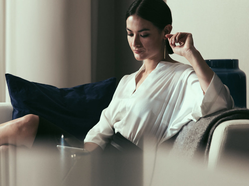 lifestyle photographer Tim Cole shoots lady relaxing on the sofa