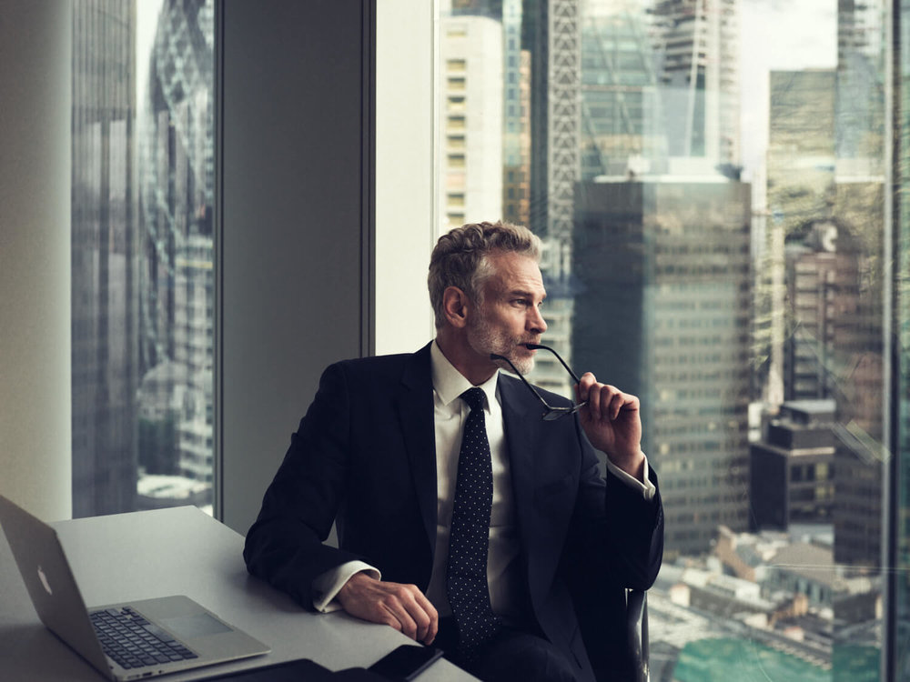 lifestyle photographer Tim Cole shoots man looking out of an office window
