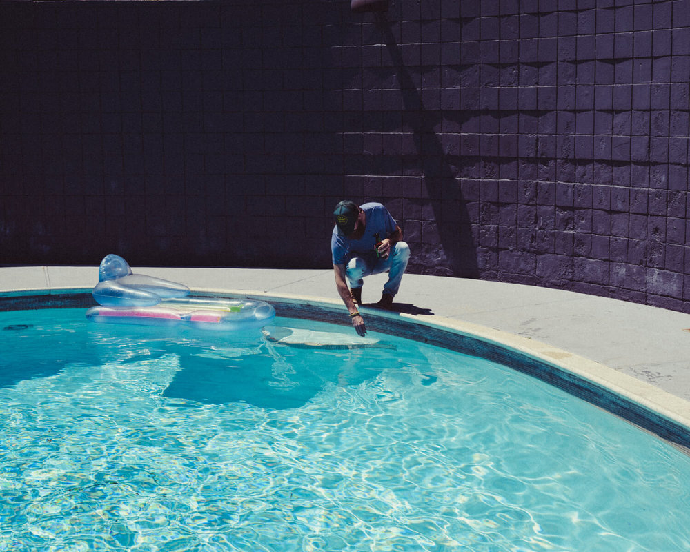 lifestyle photographer Tim Cole shoots man by pool