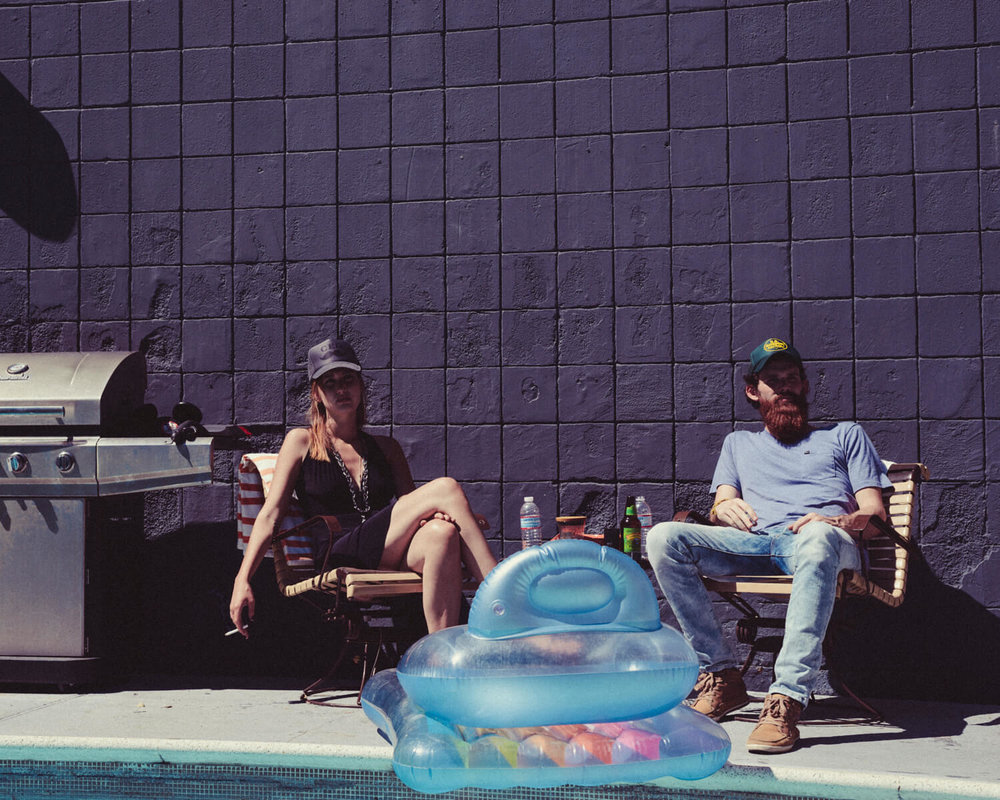 lifestyle photographer Tim Cole shoots girl and boy by the pool