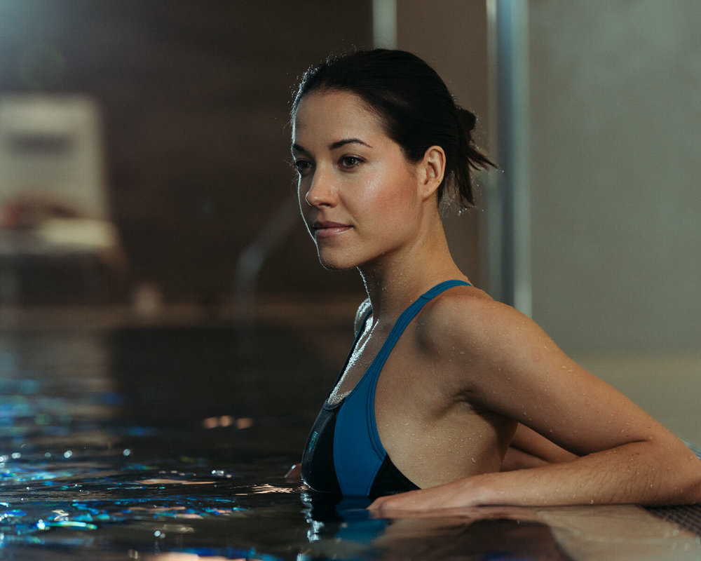 lifestyle photographer Tim Cole shoots woman in the pool