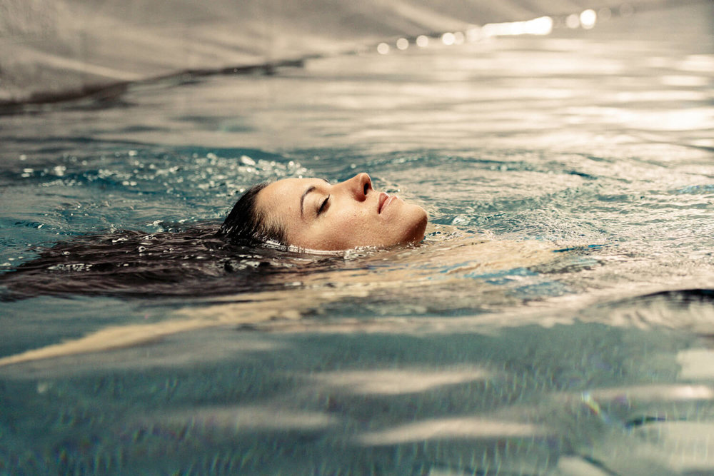 lifestyle photographer Tim Cole shoots woman in a swimming pool