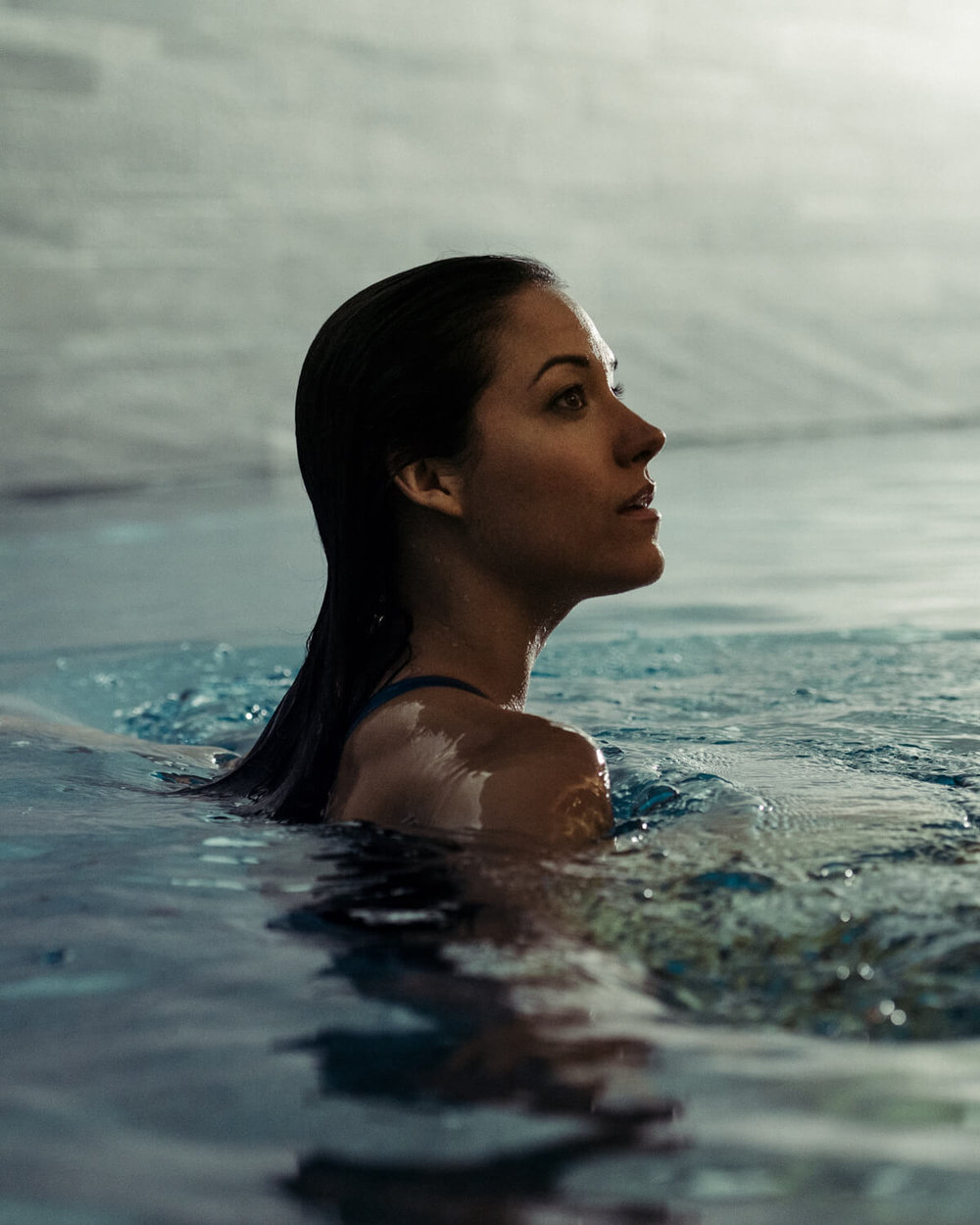 lifestyle photographer Tim Cole shoots woman in the swimming pool