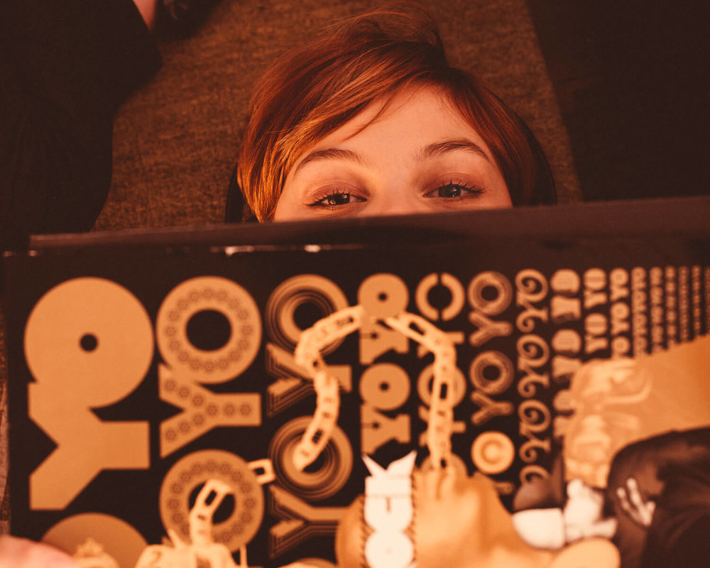 lifestyle photographer Tim Cole shoots girl looking at records