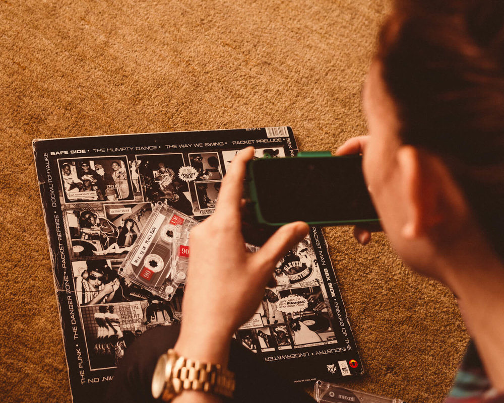 lifestyle photographer Tim Cole shoots girl making a mix tape