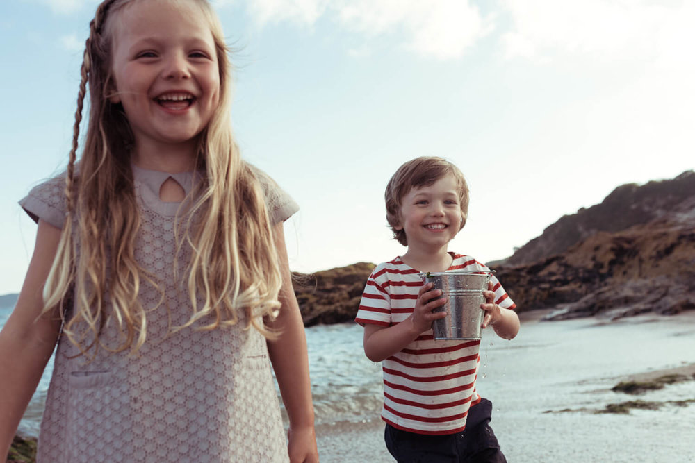 lifestyle photographer Tim Cole shoots portraits of two children on the beach