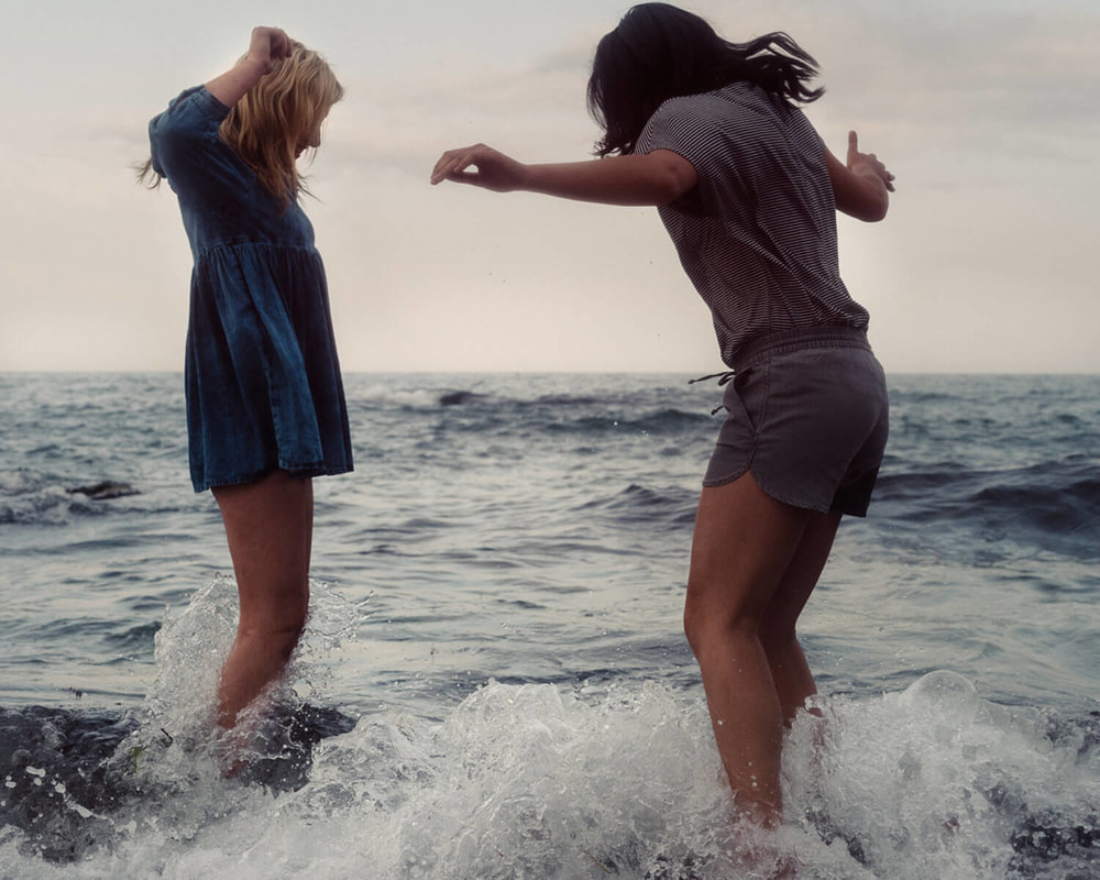 lifestyle photographer Tim Cole shoots two girls in breaking waves