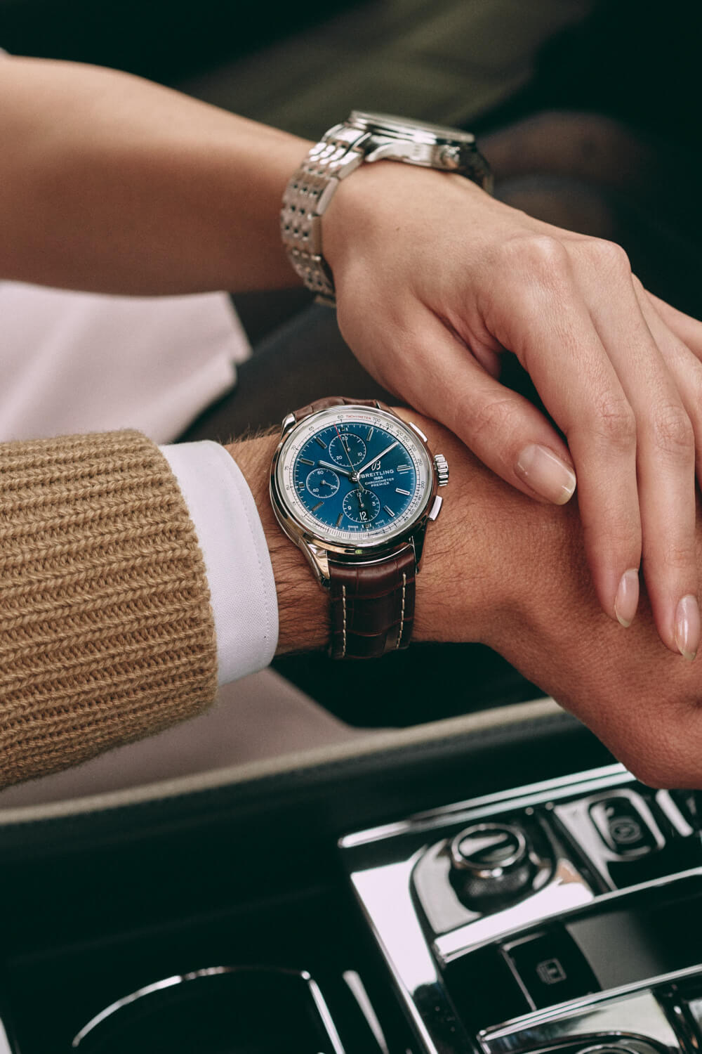 lifestyle photographer Tim Cole shoots man and woman wearing Breitling watches