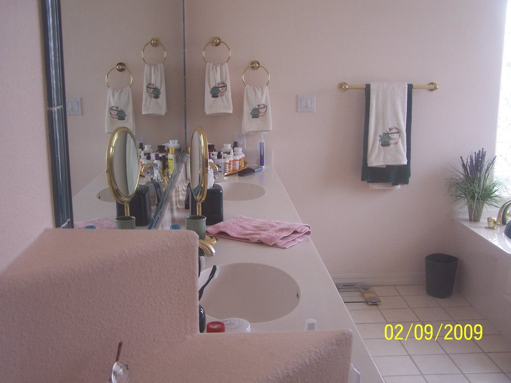 "Before    Existing vanity, the archway in the ""after"" photo was placed right at the towels hanging on the wall, opening to the new addition."