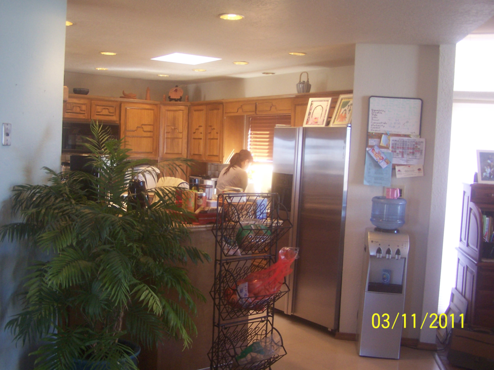 Before-View of old kitchen area, soon to be new dining room.