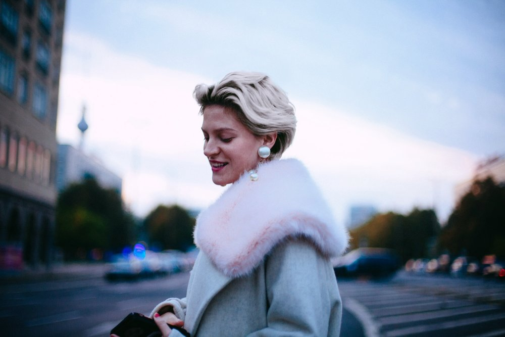 Walking the streets of Berlin in a gifted coat.                                                            © Cherie Birkner