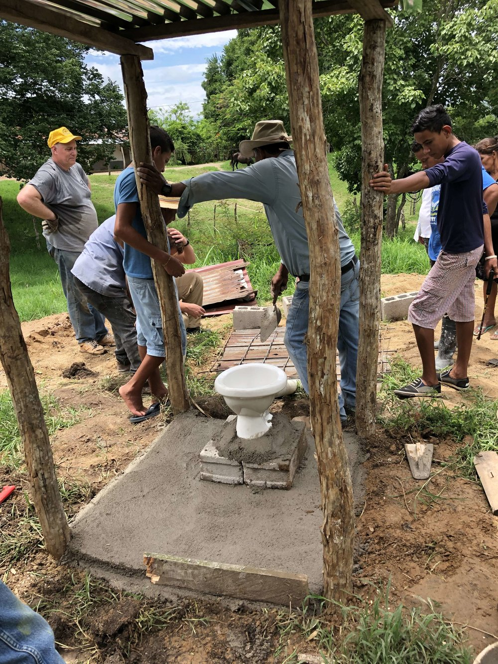 The missions team worked alongside villagers to improve sanitation by constructing cinderblock latrines.