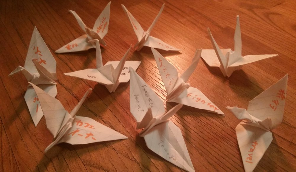 Origami cranes and curiosities collected from children in Matsubaen homes in Tokyo.