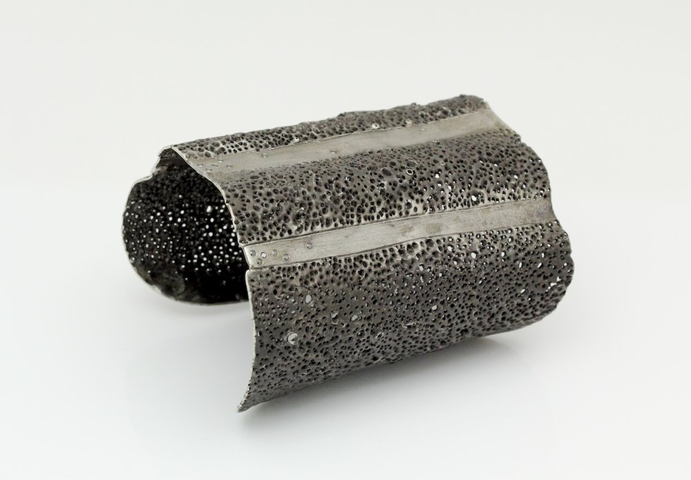"Pierce and Stripe Cuff,  2011, oxidized silver, black diamonds, 2.5""x 3""x 2"""
