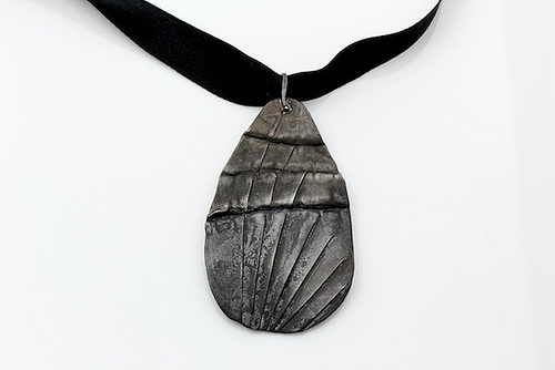 "Medium Pendant Seven , 2011, oxidized silver, black ribbon, 1.75"" x 3.25"""