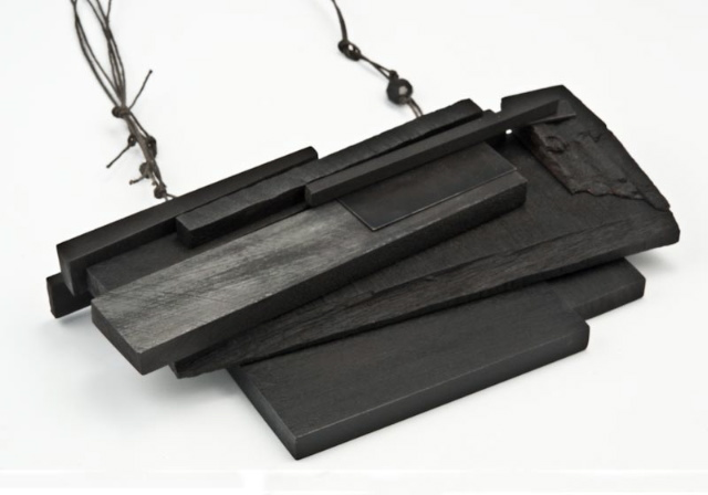 above necklace: Black Pile, wood, paint, steel, gray string
