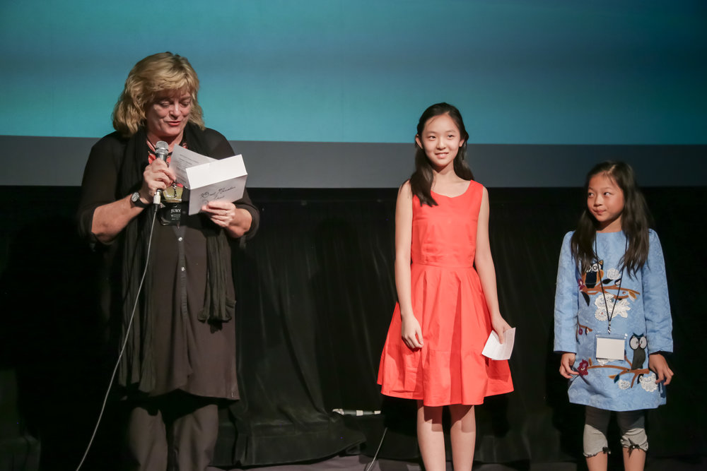 Jury member Gabrielle Kelly presents the Best Fiction Short Award (left) while leading actress Eva Du accepts for the film,  Jie Jie  (center).