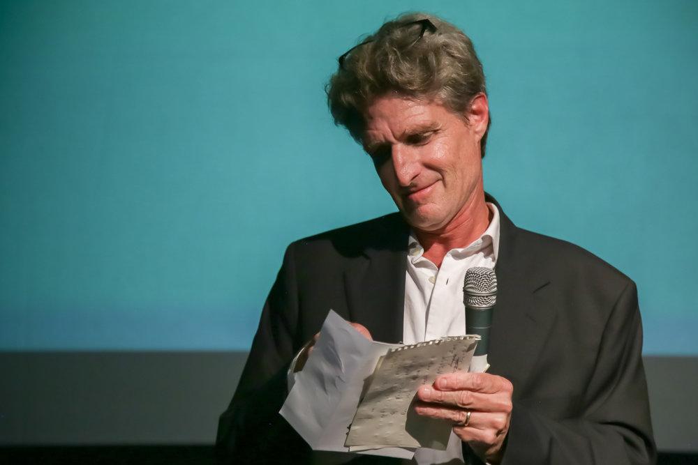 Jury member Jeff Swimmer presents the Best Documentary Short Award.
