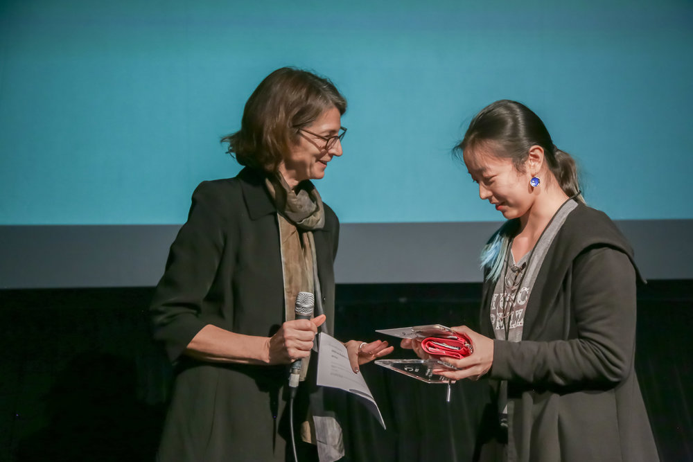 Jury member Rebecca Baron (left) presents the Independent Spirit Award to Xiaosha Zhang (right) director of  E.T. Made in China.