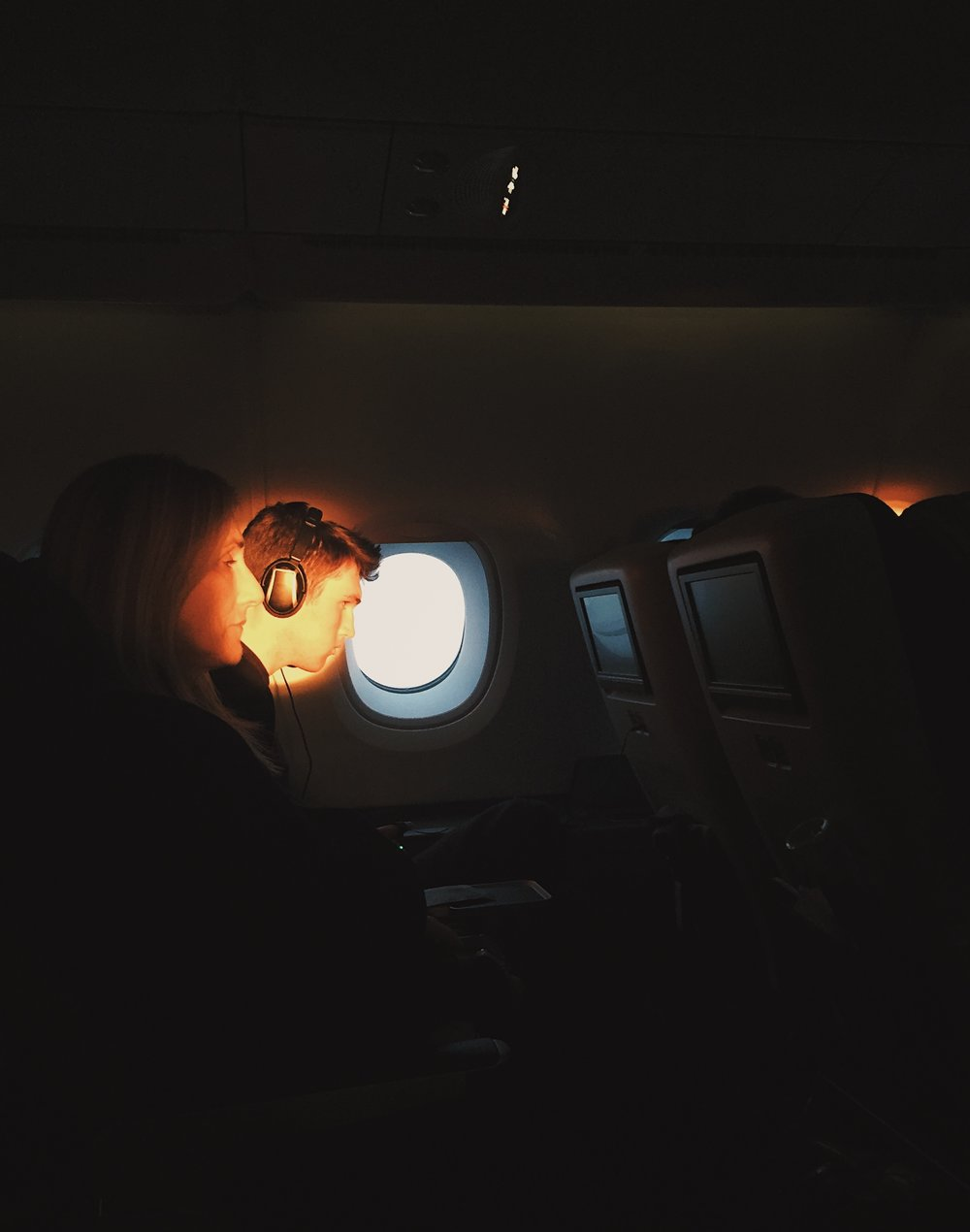 I love this photo - it's of my mom & brother during the flight while the sun was rising :)