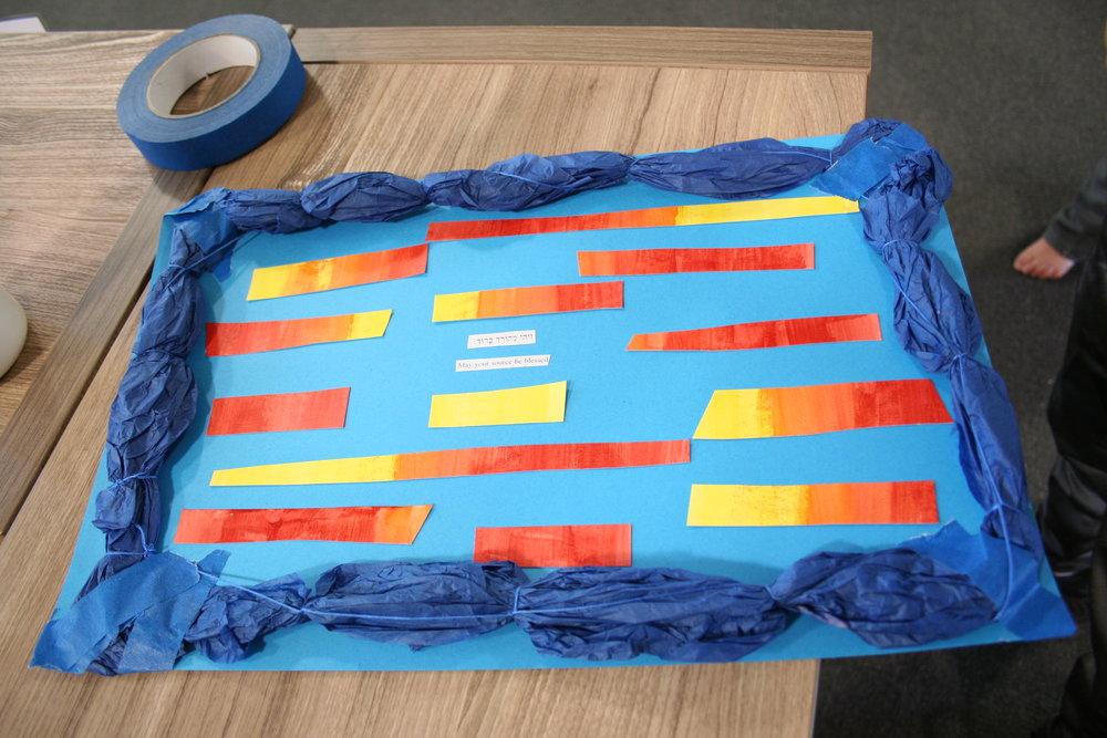 Daniel created a sign for Elijah, incorporating Elijah's favorite navy blue color.