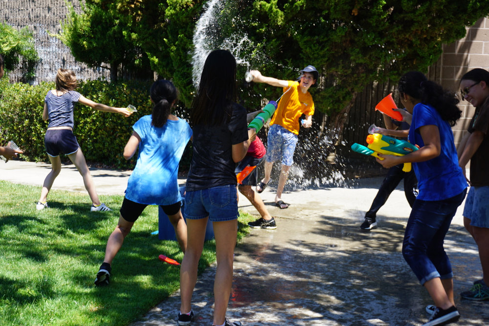 senior campers enjoying some unstructured playtime during water olympics