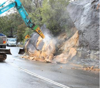 The photo shows landslip remediation, not road-widenting.
