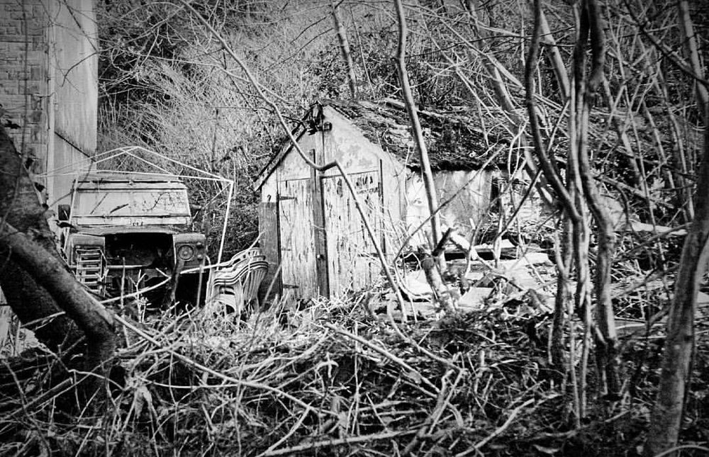 I run or cycle past this place every couple of days. The haunted garage, destroyed landrover.