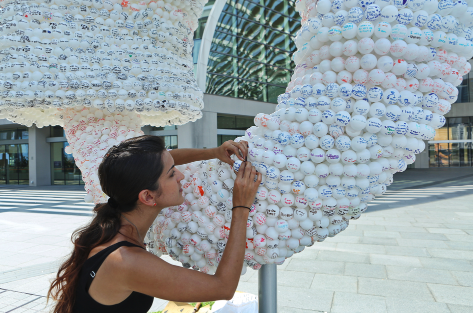 Ouroboros (Nicola at work installing the sculpture), Nicola Anthony, 2015