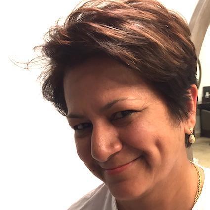 Ms Dina Medland