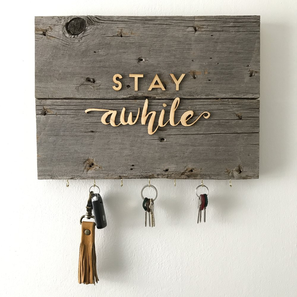 2. Key Holder   Turn your favorite phrase into something handy. This key holder is the perfect functional welcome sign to any entry way. Give your new set of keys a home too, and you'll never have to look for them again. Each holder is made to order, so you're sure to get just what you're looking for with customizable text options.