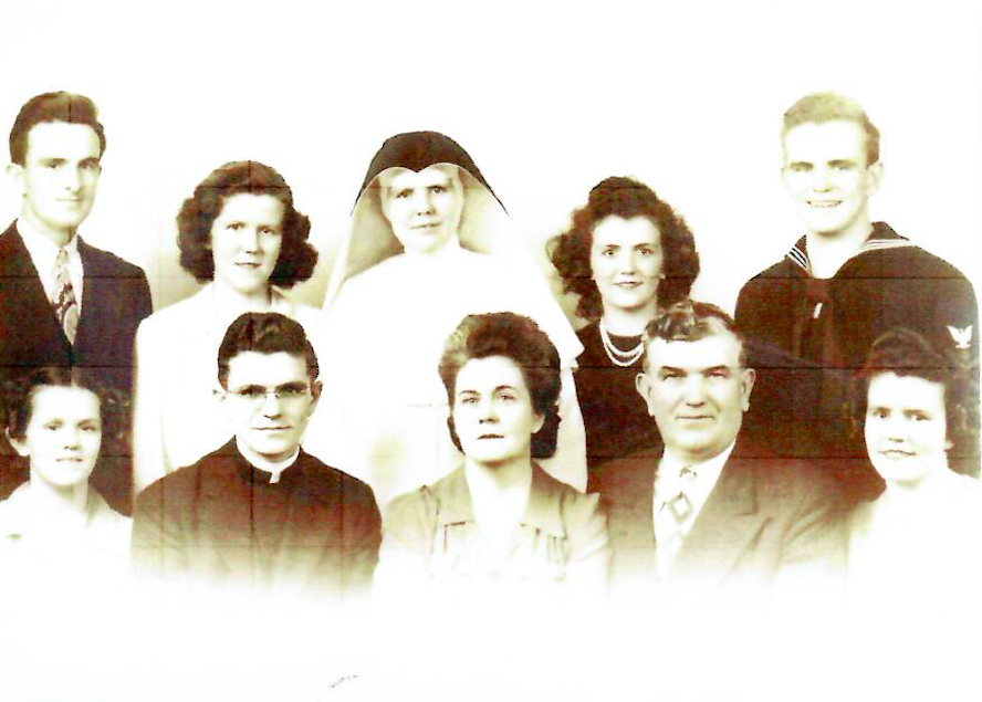 Back Row Left to Right: Martin, Agnes, Mary Ann (Sister Ellen Patricia) Anne Louise and Daniel  Front Row Left to Right: Ellen, Father Patrick, Mary Elizabeth (Mother), Patrick J. (Father), Margaret